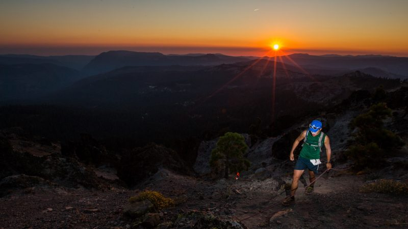 A runner emerging from Sugar Bowl's notorious Palisades at the Castle Peak 100k. Photo courtesy Scott Rokis.